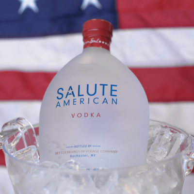 salute bottle in front of flag